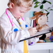 Royalty-Free Stock Photo: Little doctor with clip board