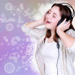 Portrait of singing cute teenage girl in headphones — Stock Photo