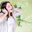 Portrait of singing cute teenage girl in headphones — Stock Photo #15432579
