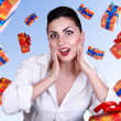 Stock Photo: Surprised pinup girl with gift boxes