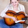 Royalty-Free Stock Photo: Teenage girl learning playing by guitar