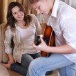 Teenage boy playing on guitar for his girlfriend — Stock Photo