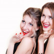 Two beautiful smiling surprised girls — Stock Photo
