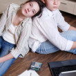 Royalty-Free Stock Photo: Two teenagers are tired doing their lessons