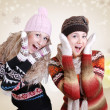 Two pretty laughing surprised girls in winter clothes — Stock Photo