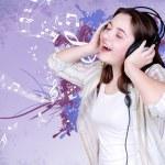 Portrait of singing teenage girl in headphones — Stock Photo