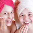 Stock Photo: Two teenage girlfriends care for face skin