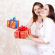 Mother and daugter with presents — Stock Photo