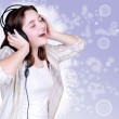 Portrait of singing cute teenage girl in headphones — Stock Photo #15432847