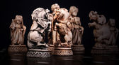 Chess pieces of horses stylized like mini sculptures — Stock Photo