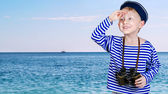 Little ship boy with binocular in hands — Stock Photo