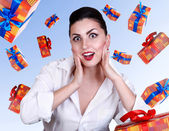 Surprised pinup girl with gift boxes — Stock Photo