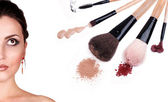 Woman portrait with cosmetics and makeup brushes — Stock Photo