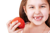Smiling pretty little girl without teeth — Stock Photo