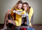 Two beautiful girls with money — Stock Photo