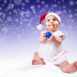 Funny baby girl in santa hat — Stock Photo