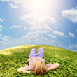 Lying on green grass carefree boy — Stock Photo