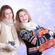 Two girlfriends with christmas presents - Stock Photo