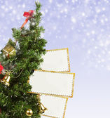 Christmas Tree with greeting postcards — Stock Photo
