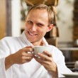 Kindly smiling man portrait with cup of morning coffee — Stock Photo