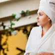Woman in white bathrobe and towel — Stock Photo #18505089
