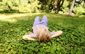 Little boy rest on the green park meadow — Stock Photo