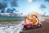 Travel concept image with baby in suitcase — Stockfoto