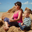 Mother and son in sitting relaxation pose — Stock Photo