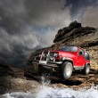 Stock Photo: Offroad vehicle on mountain terrain