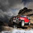 Offroad vehicle on the mountain terrain — Stock Photo #19616923