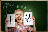 Emotional screaming pupil boy near chalkboard — Photo