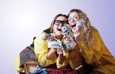 Incredibly happy girls with money win — Stock Photo