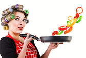 Pin up housewife cooking fresh vegetables — Stock Photo