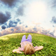Stock Photo: Lying on green grass carefree little boy