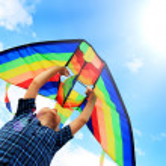 Llittle boy flies a kite in the sky — Stock Photo #23548029