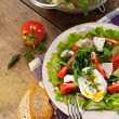 Fresh lidht salad with poached egg — Stock Photo