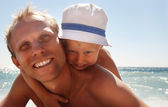 Happy father with son at the sea side — Stock Photo