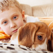 Closeup portrait boy with puppy - Stock Photo