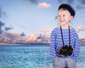 Little ship boy with binocular — Stock Photo