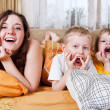 Playful children in morning bed — Stock Photo