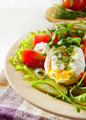 Closeup pouched egg in fresh light salad — Stock Photo
