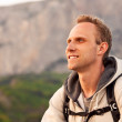 Young man height enjoy after climbing on the mountain — Stock Photo
