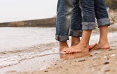 Closeup image barefoot couple legs — Photo