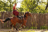 Trick on the galloping horse — Stock Photo