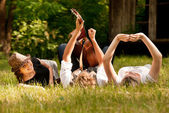 Carefree teenagers lying in grass — Stock Photo