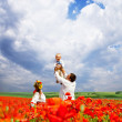 Happy ukrainian family on the field — Stock Photo #26354649