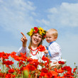 Mother and son portrait in poppies field — Stock Photo