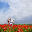 Mother and son on the poppies field — Stock Photo