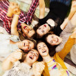 Circle of happy teenage friends — Stock Photo