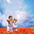 Happy couple on poppies field 3 — Stock Photo